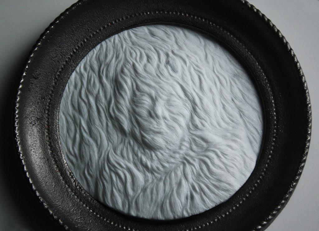 Portrait on a fur (detail), marble, iron, 2016